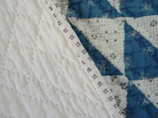 closeup binding and quilting