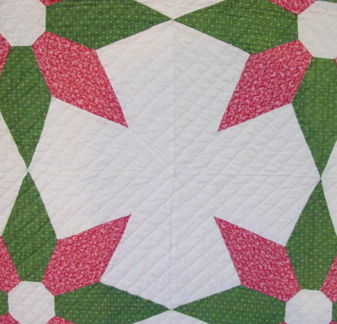 view of some of the piecing and  the center between the daisys