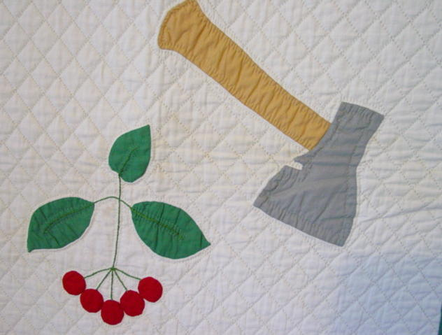 detail applique cherry limb and hatchet