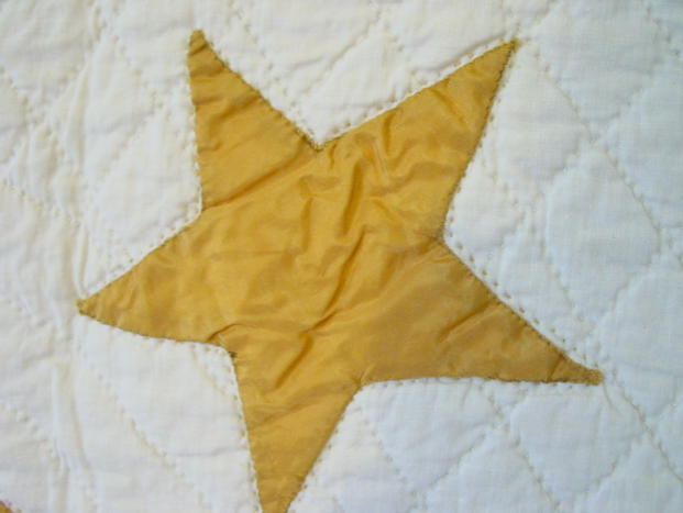 close up applique stars and outline quilting