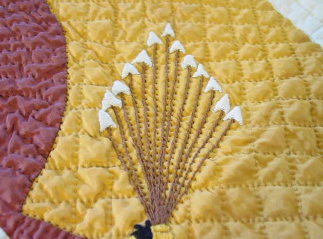 close up of hand quilting