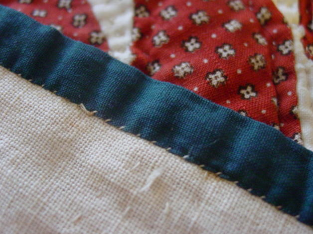 close view of hand stitched binding  and color of fabrics