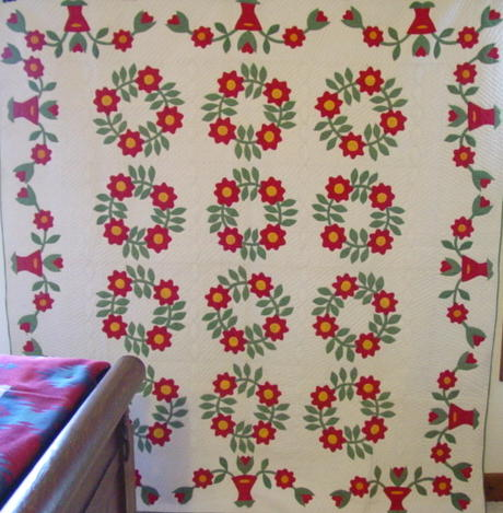full view of rose wreath and baskets of flowers quilt