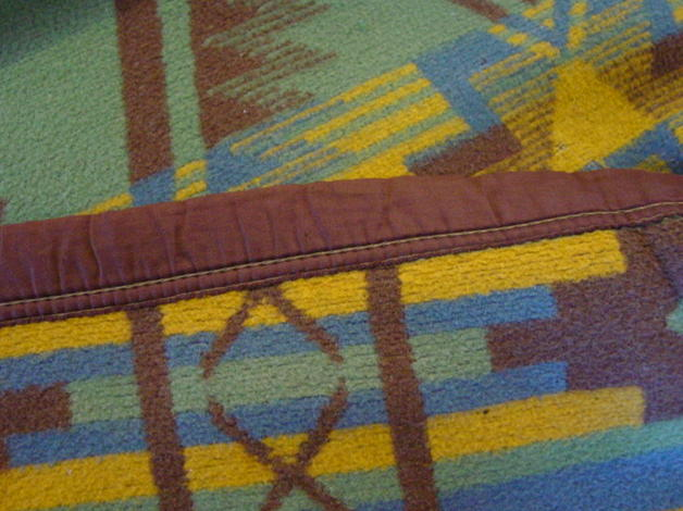 showing the end bound in brown blanket binding