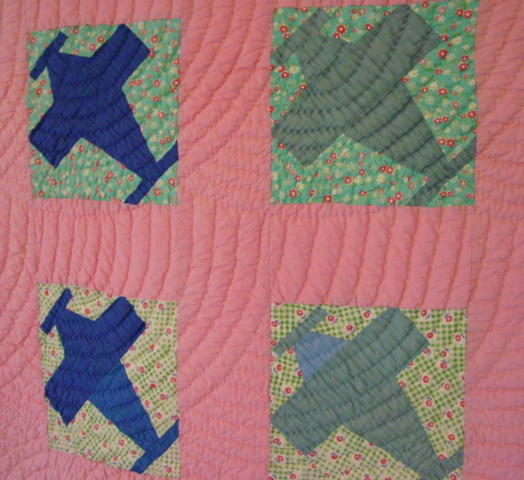 shows 4 blocks of the quilt and fabrics