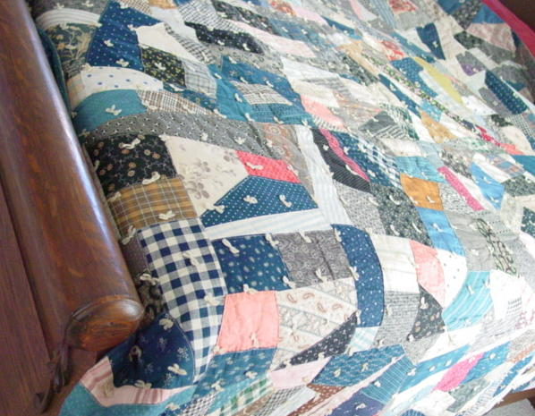 shown on a bed- just imagine an old feather bed under this quilt