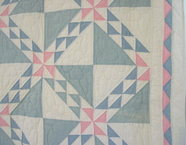 border edge of quilt and binding-one small fade spot on outer triangle
