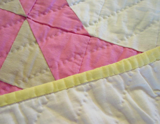 close up of binding , backing and quilting and colors