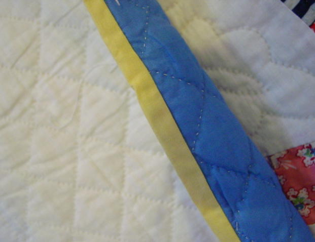 showing yellow binding and backing