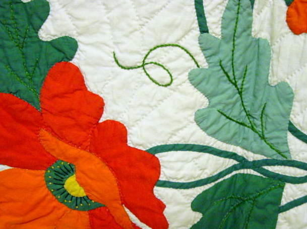 close up of workmanship - look at the applique and fine stems and petals- also shows quilting stitch