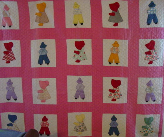 partial view of quilt-sunbonnet Sues and overall Bills