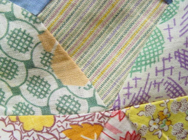 more cotton fabrics used in making this vintage quilt top