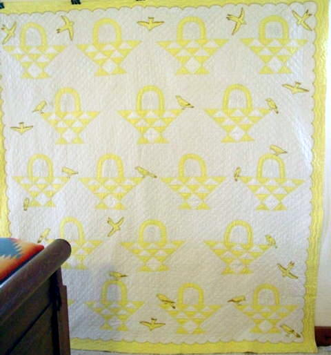 full view of the Baskets and Birds yellow and white quilt