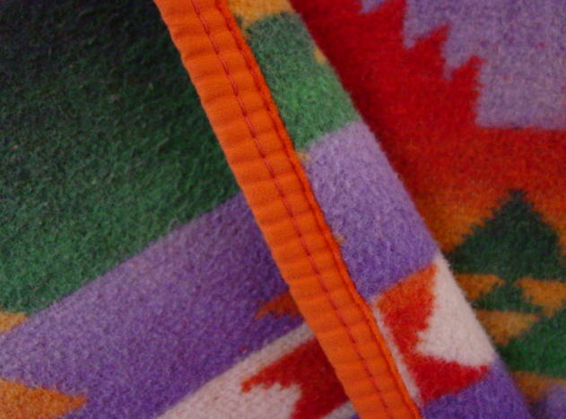 close up shows texture of the cotton blanket