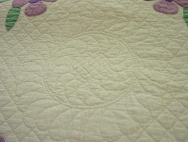 look at the fine quilting