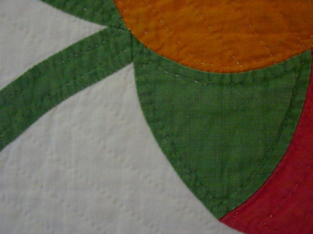 very close image of the quality quilting and applique