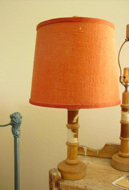 this shows lamp with an old shade