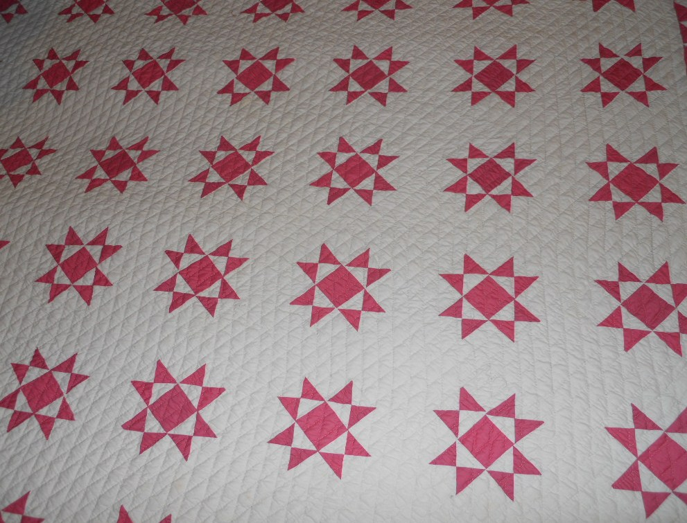 this view shows the small scale  pink and white stars-nicely made quilt