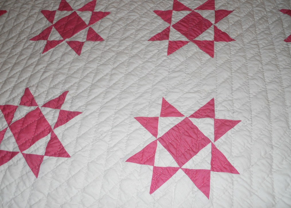 close view of the pattern and hand quilting