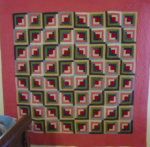 full view of Log Cabin quilt- note the light dark look and the shades of green with use of blues and pinks