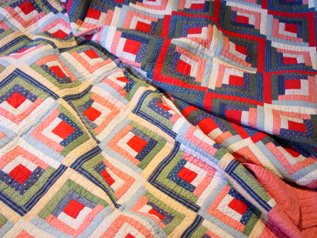 this shows 2 Log Cabins from the same estate, many of the same fabrics,, but some different, which  can change the looks of the quilt, the second Log Cabin is q-665 on the web site