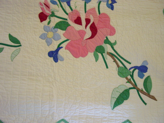 look at the quilting and hand applique