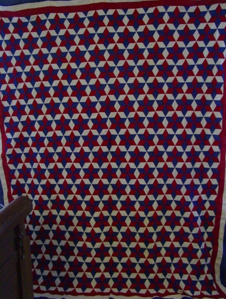 full view of Tumbling Blocks World War ll quilt top- visual, as one can see 6 point stars or baby tumbling blocks
