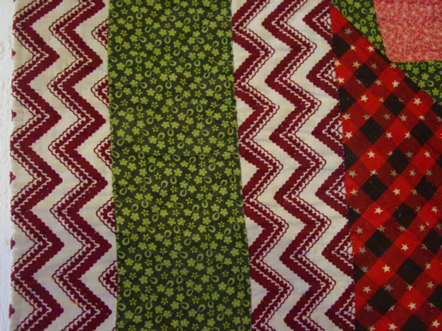 nicely hand quilted- this is the borders- great fabric