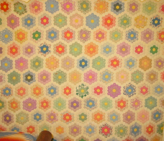 view of Grandmothers Flower Garden vintage quilt