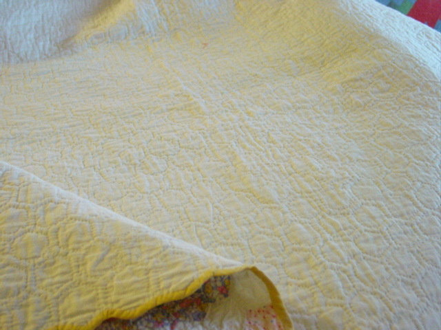 view of the backside- quilted by the piece