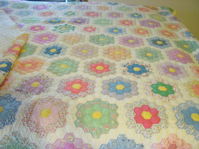 view of the quilt on a bed