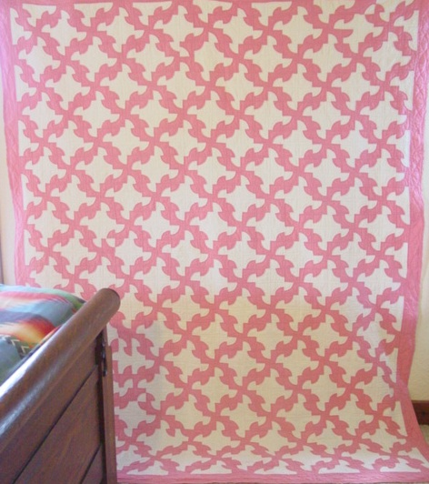 full view of the Pink and White Drunkards Path quilt