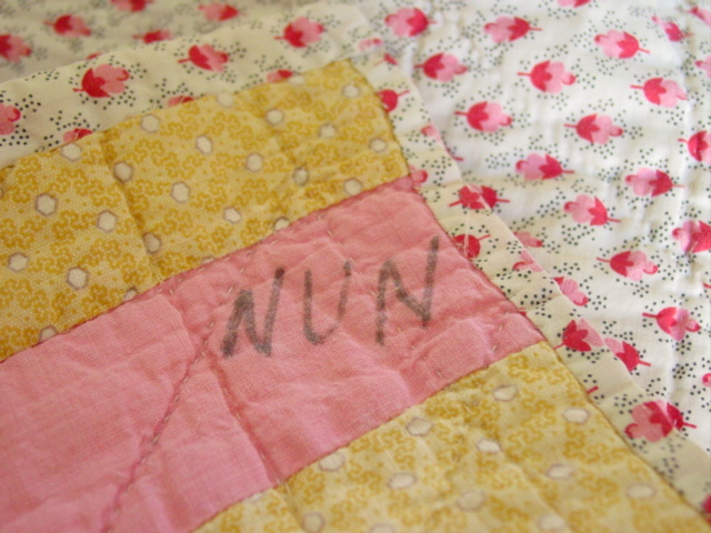 on the corner of the quilt- Nun,,