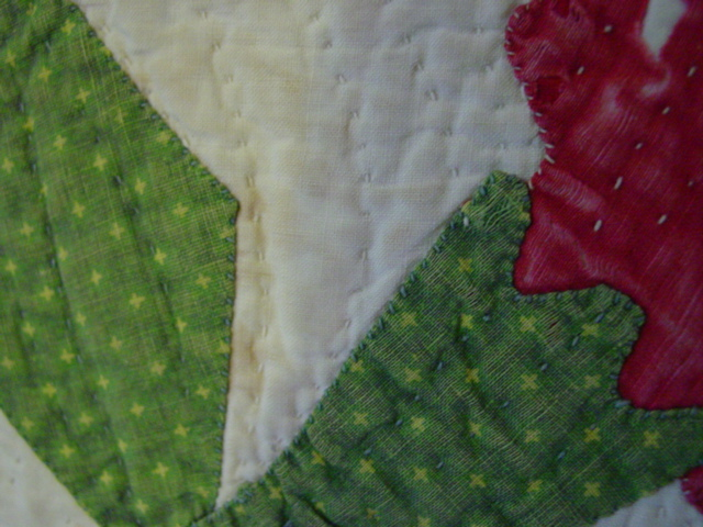 close up of quilting and applique and fabrics