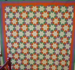 Six Point Tumbling Block Stars with Triple Border Quilt