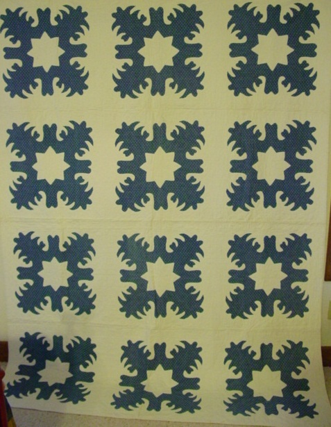 full view of the Snowflake pattern applique antique quilt