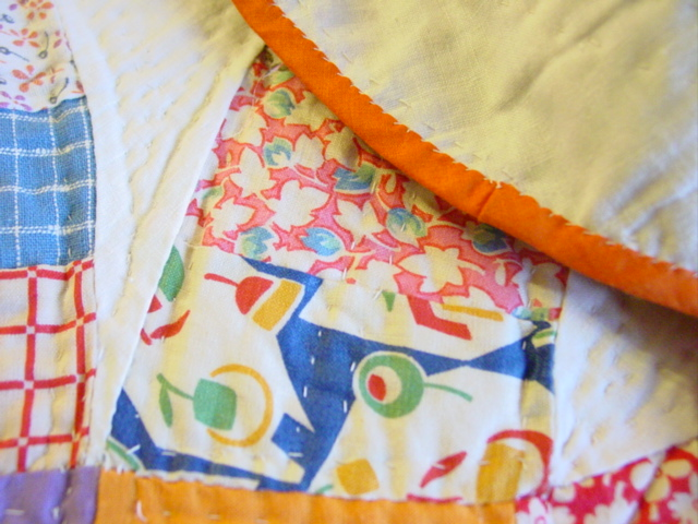 very close view of quilting and binding
