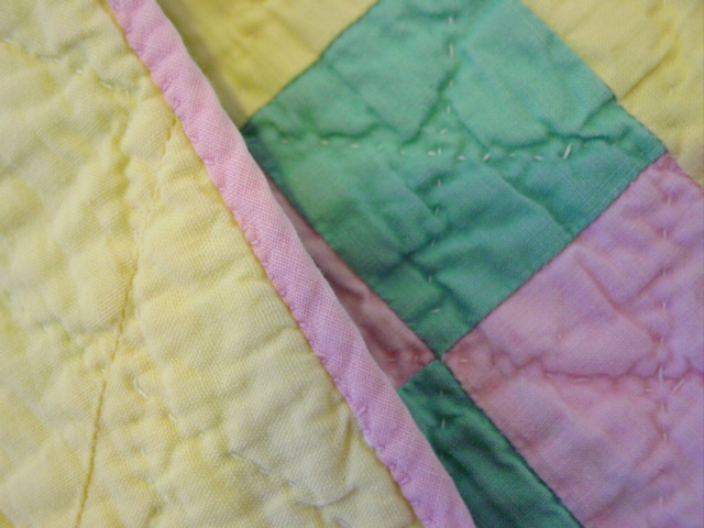 shows the binding and hand quilting
