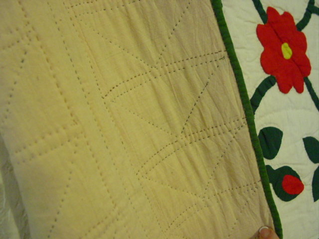 backside showing some of the quilting and binding