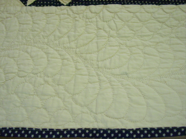 the wonderful quilting on the border and also shows binding