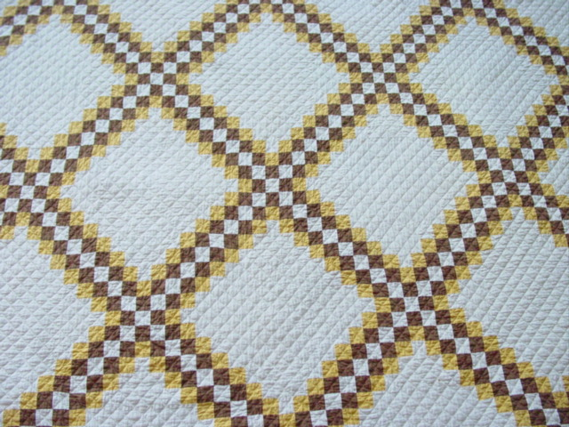 Triple Irish Chain quilt in 2 colors plus the ground color