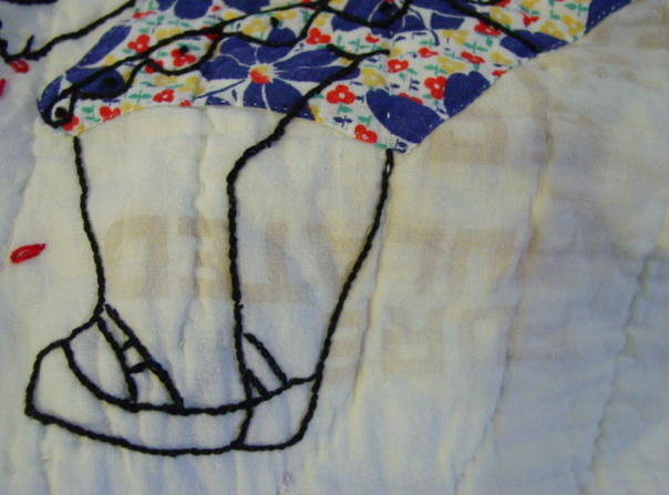 feed or sugar sacks used in making the quilt- note the lettering in the fabric