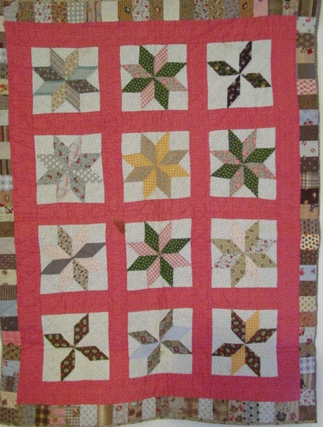 full view of 8 Point Stars Crib quilt with blocks border