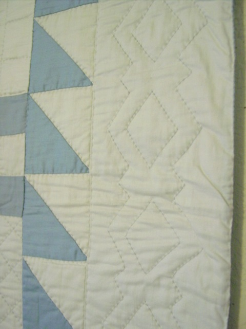 the nice quilting in the border and the edge