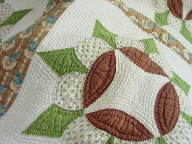 close up of some fabrics and the wonderful quilting