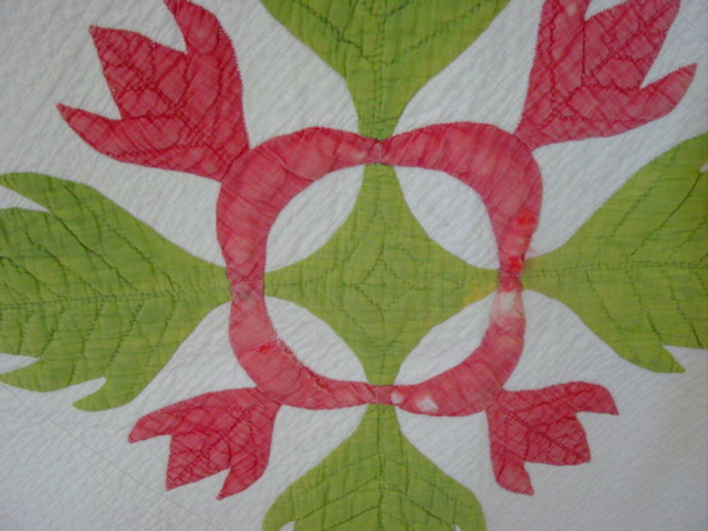 this shows some of the thinning of just the red on one of the blocks and an attempt to color it in by a previous owner