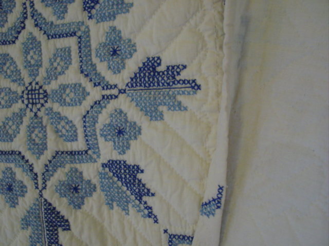 showing the edge and hand quilting