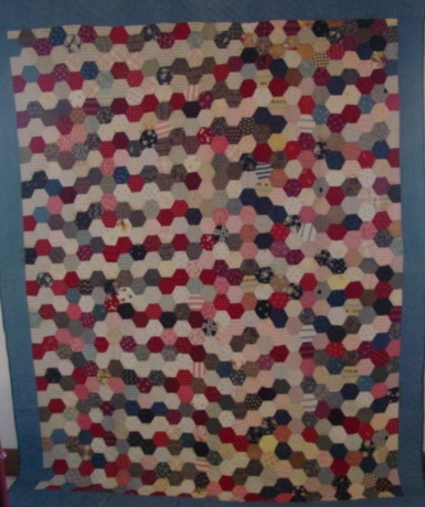 Full view of Hexagons quilt- love the way it gyrates on the right side