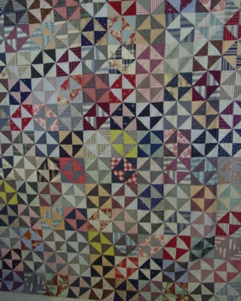 full view of Pinwheels/Triangles/Hourglass quilt top